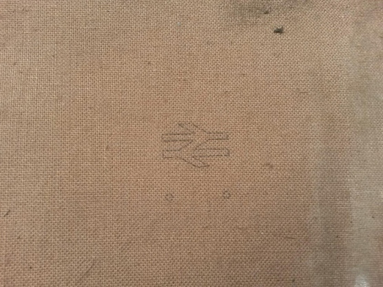 Back of Maroon Layer embossed with Double Arrow
