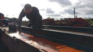Eddie applying first coat of wood preserver.